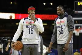 "DeMarcus ""Boogie"" Cousins (left) and Kevin Durant are among the All-Stars in the lineup spurring more envy and resentment of the Golden State Warriors."