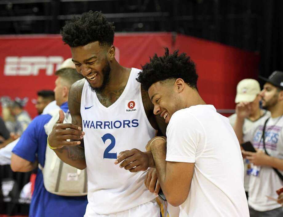 Jordan Bell of the Golden State Warriors and his Warriors teammate Quinn Cook joke around after Bell played in a 2018 NBA Summer League game against the Los Angeles Clippers at the Thomas & Mack Center on July 6, 2018 in Las Vegas.  Photo: Ethan Miller / Getty Images / 2018 Getty Images