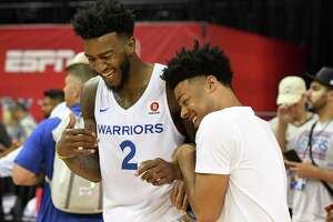 LAS VEGAS, NV - JULY 06:  Jordan Bell #2 of the Golden State Warriors and his Warriors teammate Quinn Cook joke around after Bell played in a 2018 NBA Summer League game against the Los Angeles Clippers at the Thomas & Mack Center on July 6, 2018 in Las Vegas, Nevada. The Warriors defeated the Clippers 77-71. NOTE TO USER: User expressly acknowledges and agrees that, by downloading and or using this photograph, User is consenting to the terms and conditions of the Getty Images License Agreement.  (Photo by Ethan Miller/Getty Images)