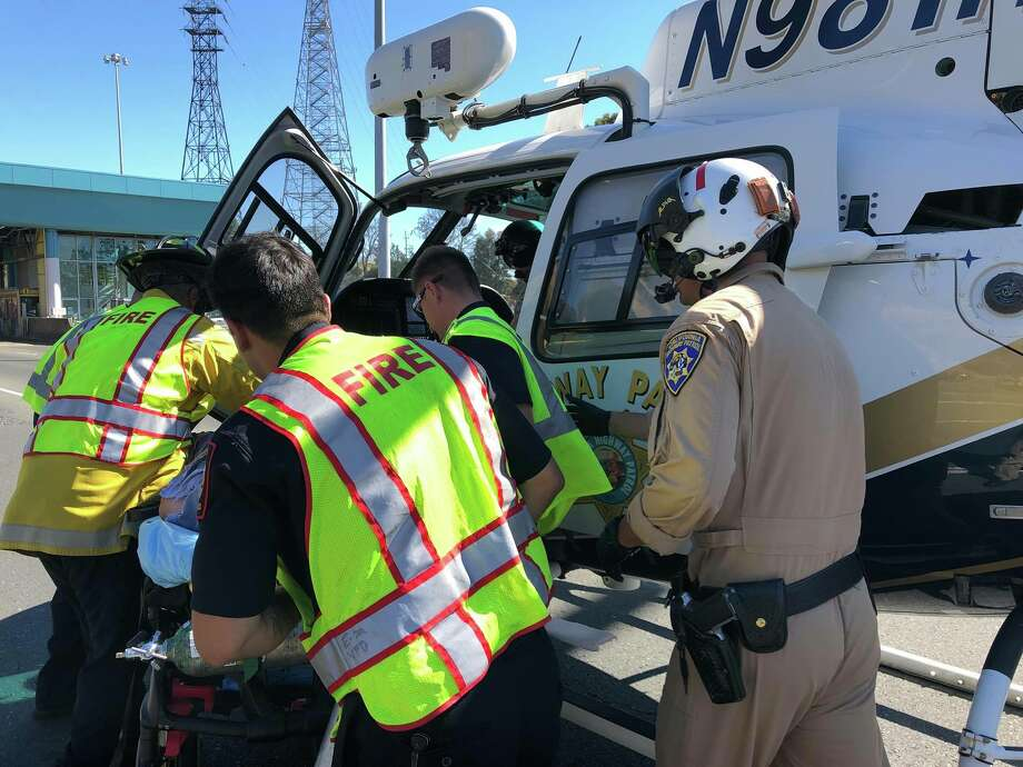 A motorcyclist is treated following a crash at the Carquinez Bridge Sunday afternoon. Photo: Courtesy California Highway Patrol