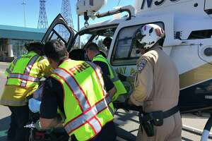 A motorcyclist is treated following a crash at the Carquinez Bridge Sunday afternoon.