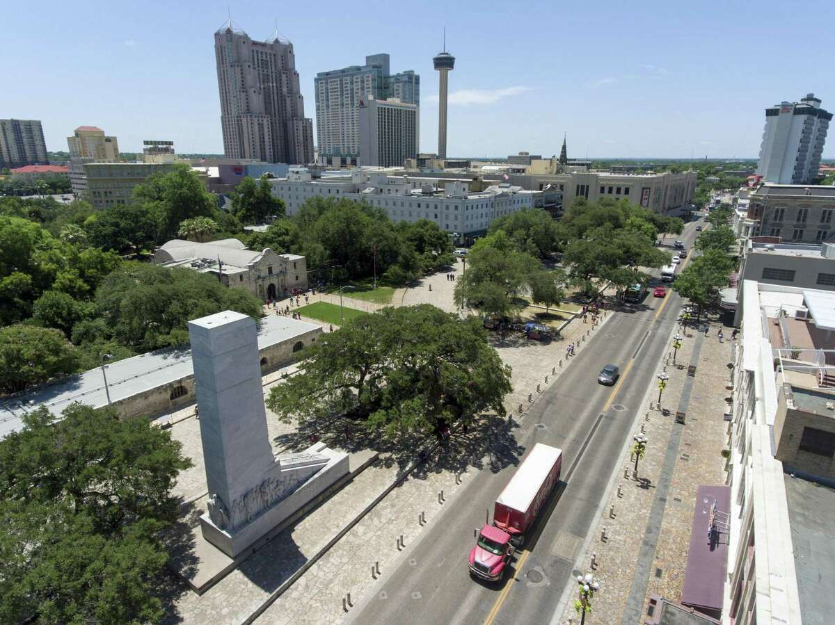 Vehicles drive on Alamo Street in front of the Alamo and the Cenotaph. A proposed Alamo Plaza renovation plan calls for, among other changes, closing Alamo Street and moving the Cenotaph 500 feet to the south, putting it close to the front of the Menger Hotel.
