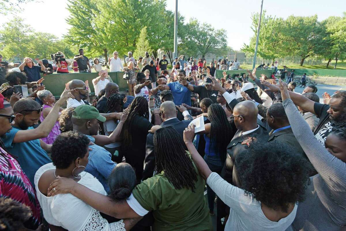 People attending a community gathering at Arbor Hill Park come together to pray for the families who have been affected by the recent gun violence in the city on Sunday, July 8, 2018, in Albany, N.Y. (Paul Buckowski/Times Union)