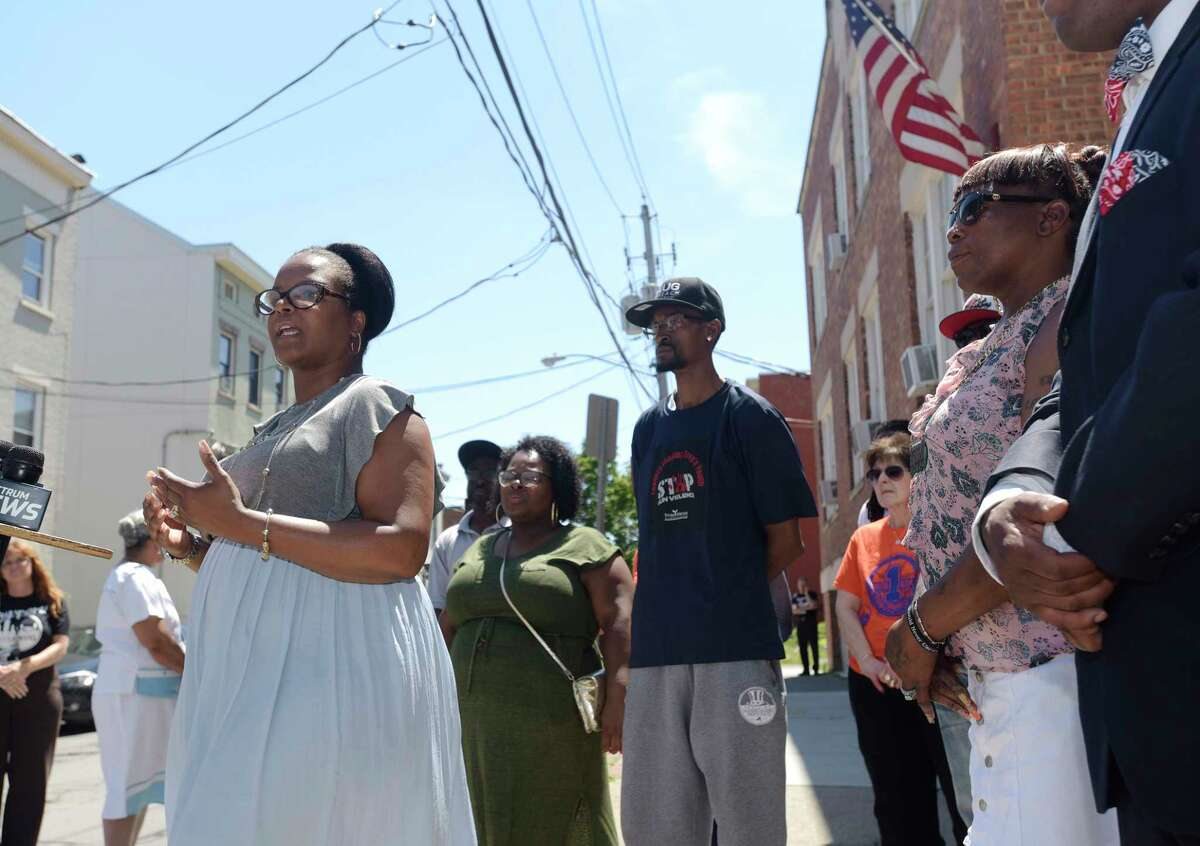 Lisa Good, the founder Urban Grief, a victim's outreach program, talks about shootings in the city of Albany, N.Y., during a press conference outside of Trinity Alliance on Sunday, July 8, 2018. (Paul Buckowski/Times Union)