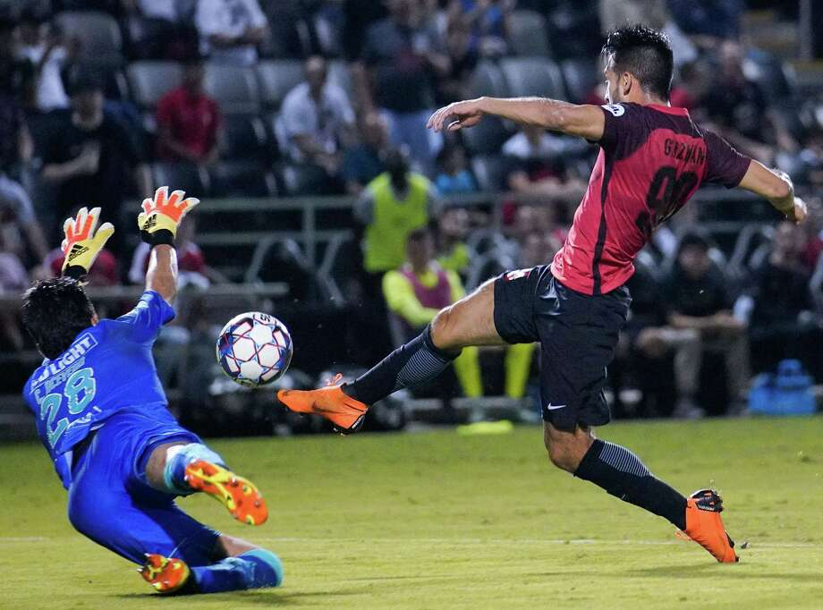 San Antonio FC's Ever Guzman takes a shot past Santos Laguna goalkeeper during the second half. Guzman scored the winning goal off the rebound. Photo: Darren Abate /USL / Darren Abate Media LLC