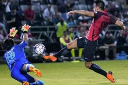 San Antonio FC's Ever Guzman takes a shot past Santos Laguna goalkeeper during the second half. Guzman scored the winning goal off the rebound.