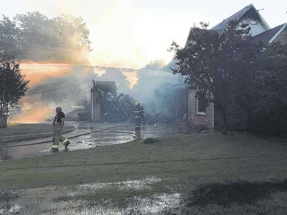 Firefighers work to put out a fire at the home of Jacksonville native Crystal Wills Nevel in New Madrid, Missouri, on Wednesday.