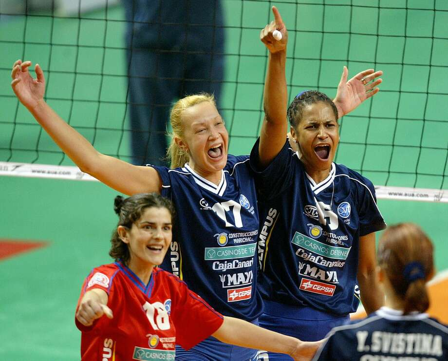 Magaly Carvajal, right, was inducted into the International Volleyball Hall of Fame in 2011. She helped the Cuban national team win gold medals in the 1992 and 1996 Olympics. Photo: Javier Soriano /AFP /Getty Images File / 2004 AFP