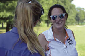 Edwardsville coach Abby Comerford's second season leading the Tigers brought 2017 Telegraph Girls Golf Coach of the Year honors.