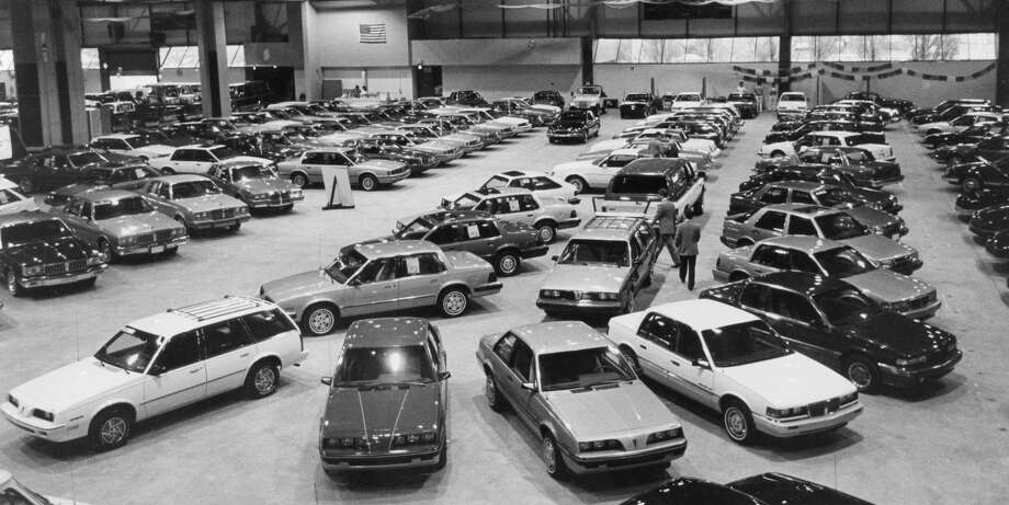 Midland Civic Arena has become a new car lot as area dealers display and sell their vehicles. The show was sponsored by the Midland Auto Dealers Association. May 1986 Photo: Daily News File Photo