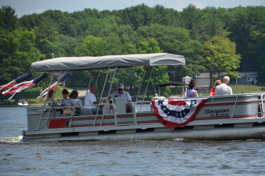A scene from the July 4 Sanford Lake Boat Parade. (Photo provided/P3 Images) Photo: Photo Provided/P3 Images