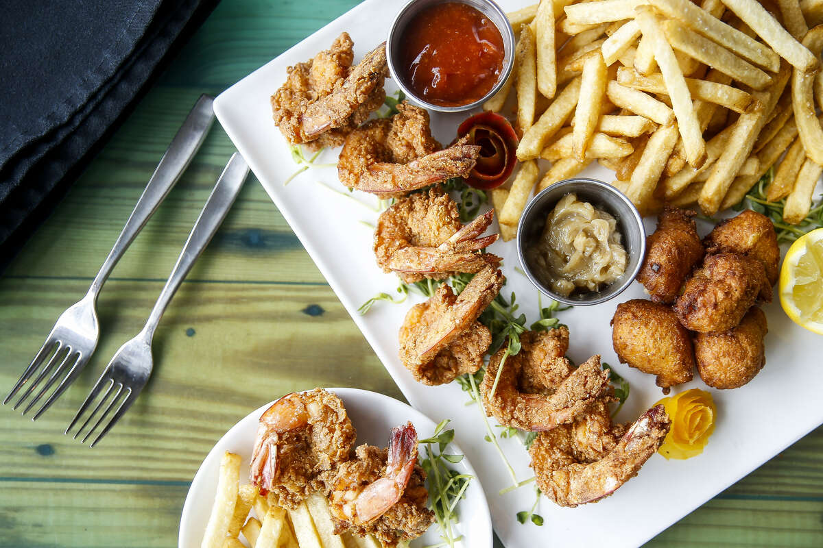 Gulf fried shrimp platter served with hand-cut fries, Carolina slaw, hush puppies and cane syrup butter at Harold's Restaurant & Tap Room.