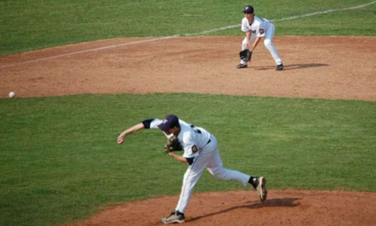 Jimmy Kopack delivers on the mound for Westport Junior Legion with teammate Jonathan Friedman preparing to make the play at third base. Kopack and Friedman have contributed to Westport's resurgence of five wins in seven games.