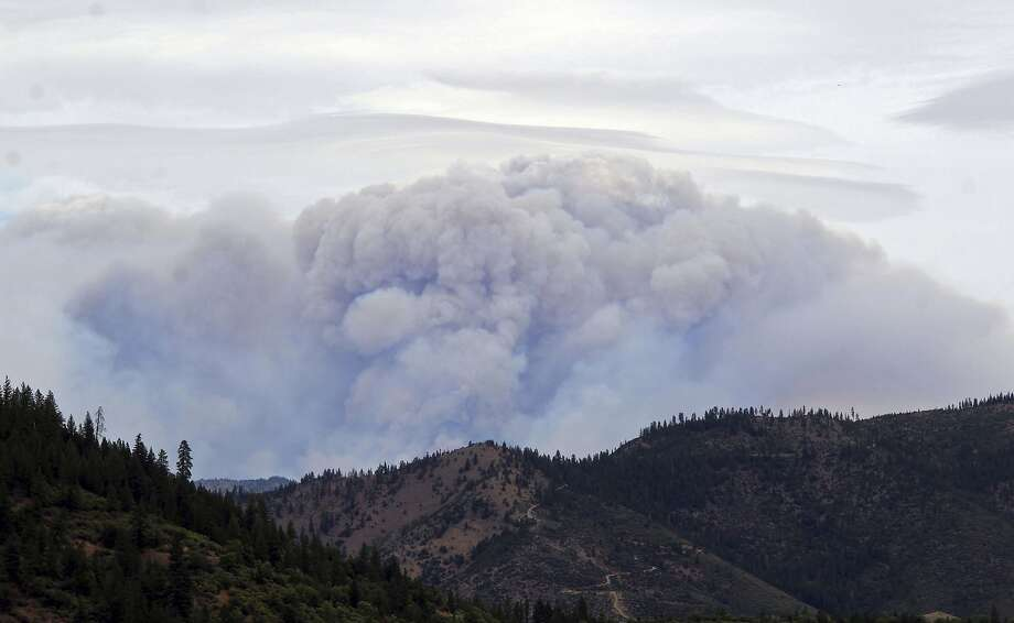 Smoke from the Klamathon Fire is seen Friday, July 6, 2018, from the top of Humbug Road in Yreka, Calif. California officials say they are temporarily closing a hatchery and two other public areas because of their proximity to a deadly blaze near the Oregon state line. The California Department of Fish and Wildlife says the Iron Gate Fish Hatchery along the Klamath River, the Klamathon Road fishing access below the hatchery and the Horseshoe Ranch Wildlife Area have been closed as a precaution. (Danielle Jester/Siskiyou Daily News via AP) Photo: Danielle Jester / Associated Press