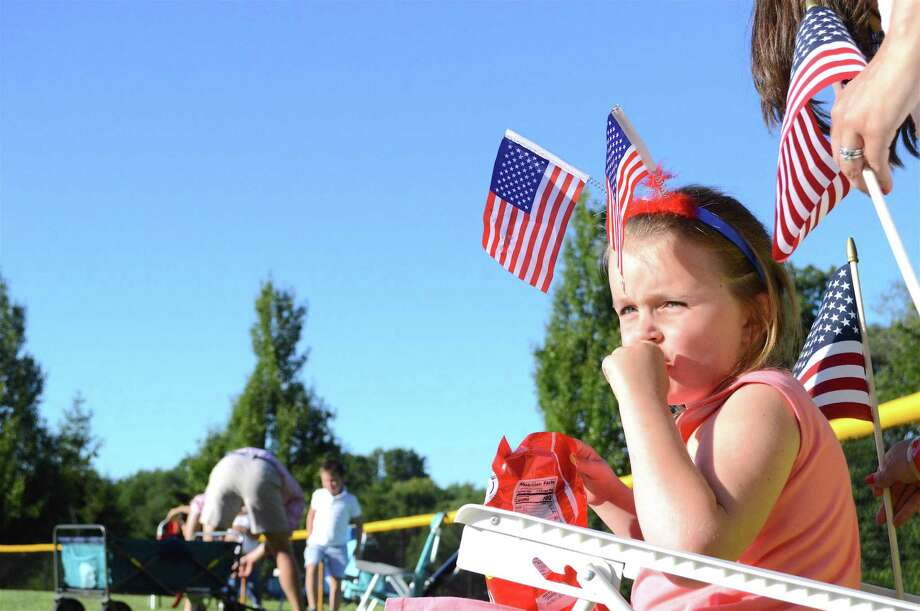 Julie Verpoorten, 5, of Darien, enjoys a pre-show snack at the Darien Fireworks on Saturday, July 7, 2018, at Darien High School in Darien, Conn. Photo: Jarret Liotta / For Hearst Connecticut Media / Darien News Freelance