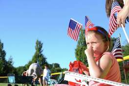 Julie Verpoorten, 5, of Darien, enjoys a pre-show snack at the Darien Fireworks on Saturday, July 7, 2018, at Darien High School in Darien, Conn.