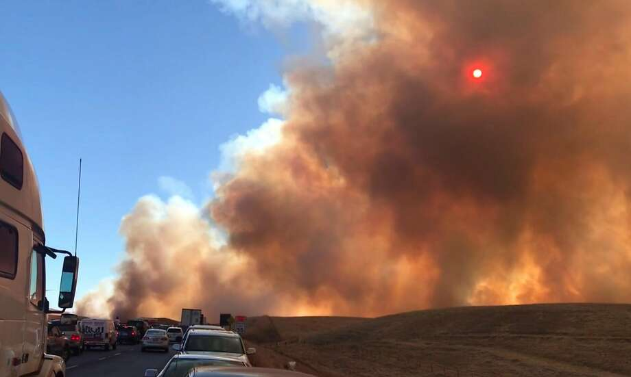 A 500-acre fire shut down Interstate 580 in both directions Sunday evening in the Altamont Pass. A 17-year-old San Joaquin County resident has confessed to setting the fire by setting off fireworks. Photo: Erin Allday / The Chronicle