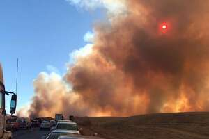 A 500-acre fire shut down Interstate 580 in both directions Sunday evening in the Altamont Pass. The Grant Fire was burning on both sides of I-580 near Grant Line Road in Alameda County. The fire was 25 percent contained as of 7:20 p.m., according to Alameda County Fire.