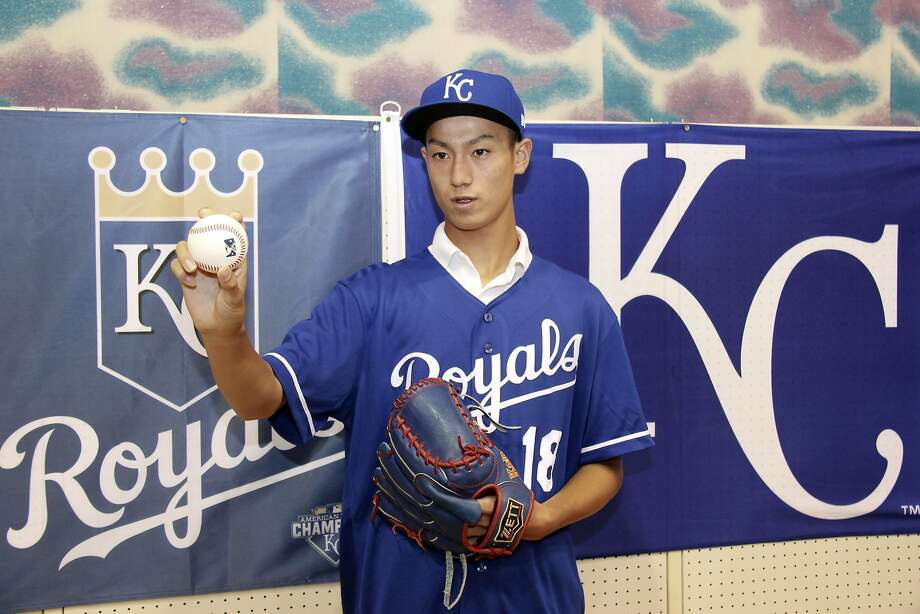CORRECTS DATE - In this July 8, 2018 photo, Kaito Yuki poses for photographers at a press conference in Osaka, western Japan. Yuki is headed to the Kansas City Royals organization instead of attending high school in Japan. The team signed Yuki, a 16-year-old pitcher, out of junior high to a standard seven-year minor league contract Sunday. He is thought to be the first Japanese junior high school player to sign with a major league club. (Kyodo News via AP) Photo: 171836+0900 / Associated Press