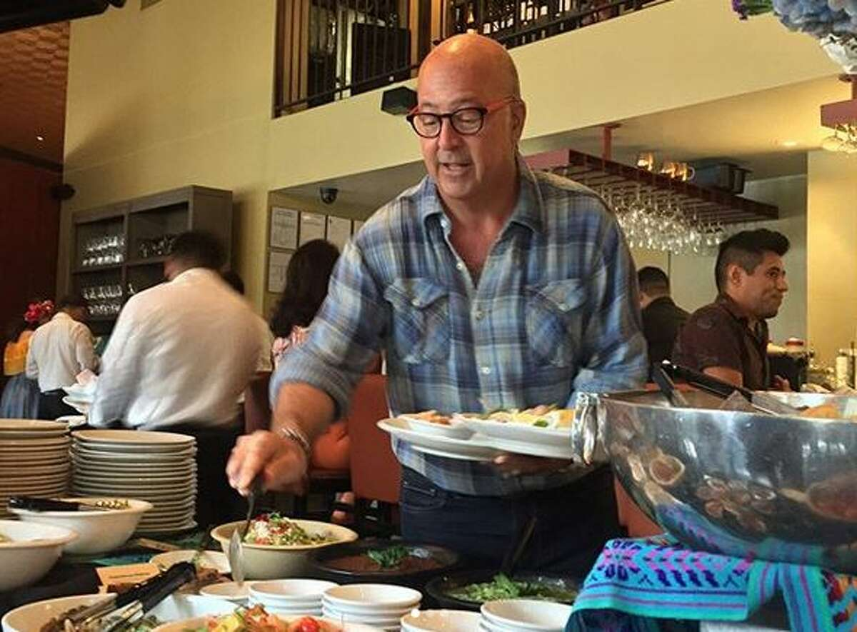 Andrew Zimmern took in brunch at Hugo's on Sunday while taping for his Travel Channel show,