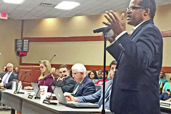 A parent speaks during public comment at a Fort Bend ISD trustee meeting held June 18.