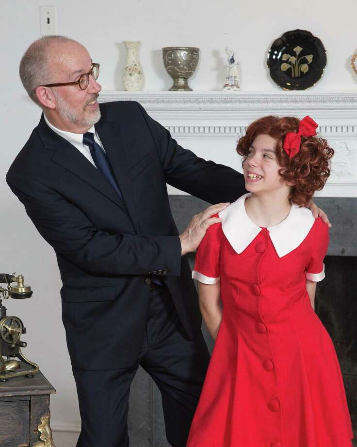 "Billionaire Oliver Warbucks, (Walter Cramer), finds that Annie, (Samantha Treppeda), has changed his life for the better in Musicals at Richter's ""Annie,"" to be performed at Richter Arts Center in Danbury, July 27-Aug. 11. Photo: David Henningsen / Contributed Photo"