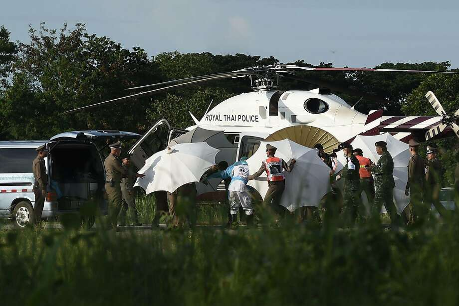 Police and military personnel in Mae Sai, Thailand, use a helicopter to rush the rescued boys to a hospital for medical care. Preparations were under way to save the five who remain in the cave complex. Photo: Lillian Suwanrumpha / AFP / Getty Images