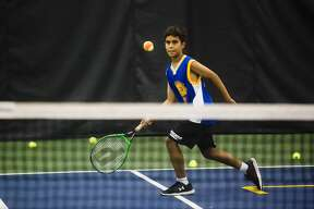 Kiran Khot works on his tennis skills during a week-long tennis camp on Monday, July 9, 2018 at the Greater Midland Tennis Center. Through Tuesday, July 10, two youths who are registered together for a tennis camp each pay half price. (Katy Kildee/kkildee@mdn.net)