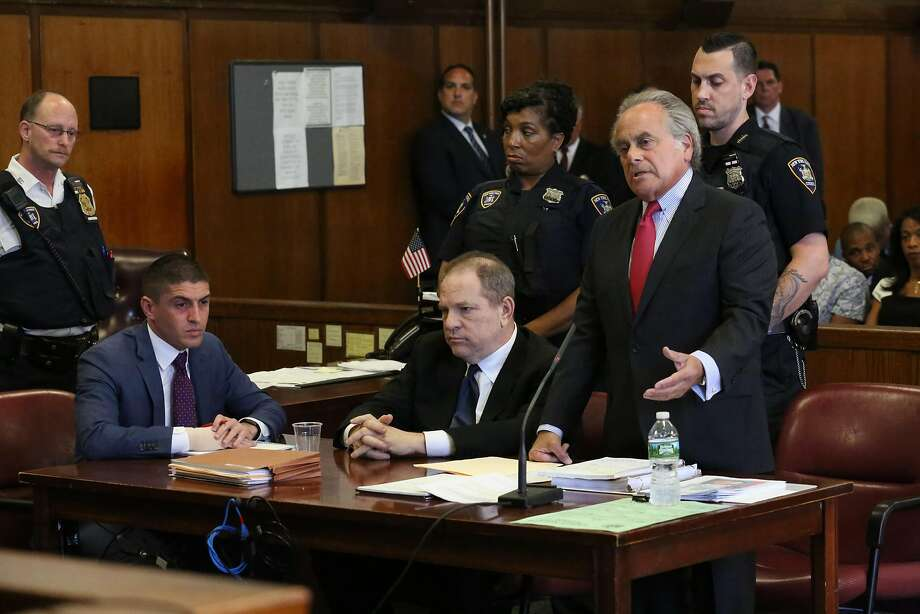 Harvey Weinstein (center) appears at his arraignment in New York City. His attorney, Benjamin Brafman (right), says he will be exonerated. Photo: Pool / Getty Images