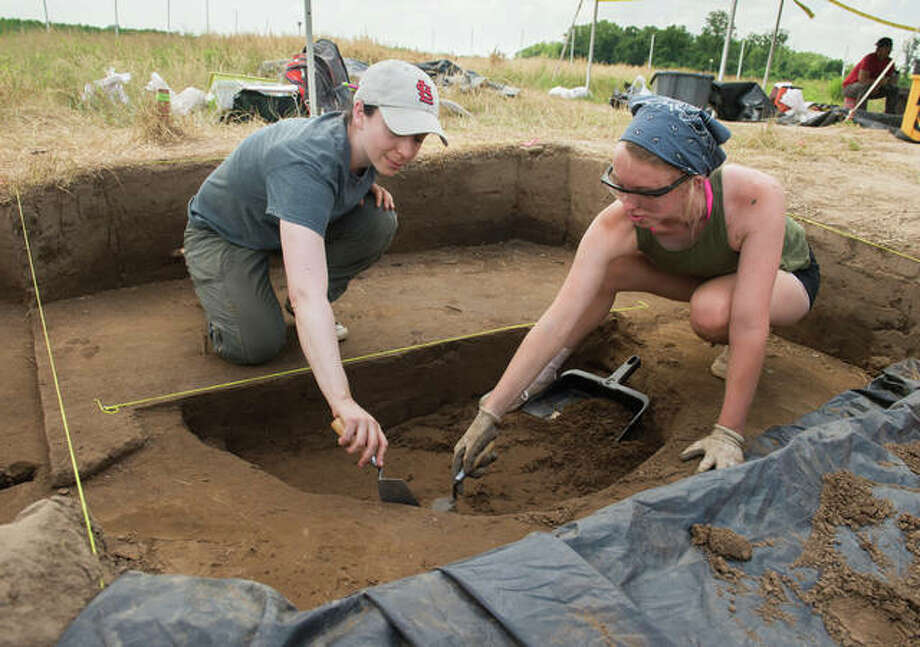 SIUE's Carol Colaninno-Meeks (left) works with REU participant Emily Lange, of Edwardsville, excavating archaeological deposits. Photo:       For The Telegraph