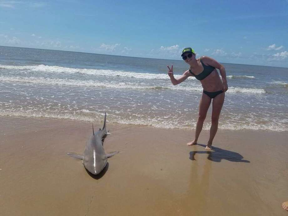 Lauren Biggers, from the Austin area, reeled in the 6- to 7-foot-long shark on Saturday morning. Photo: Lauren Biggers