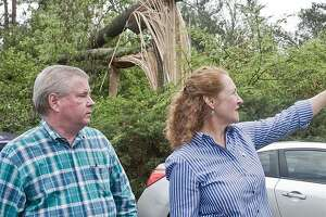 U.S. Rep. Elizabeth Esty and Brookfield First Selectman Stephen Dunn exam a fallen tree on Mist Hill Road in Brookfield in June.