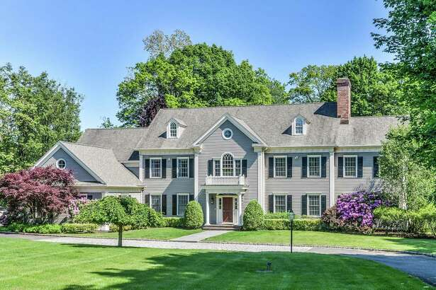 The gray clapboard colonial house at 184 Cross Highway is in the Long Lots neighborhood convenient to the Rolnick Observatory and many local amenities.