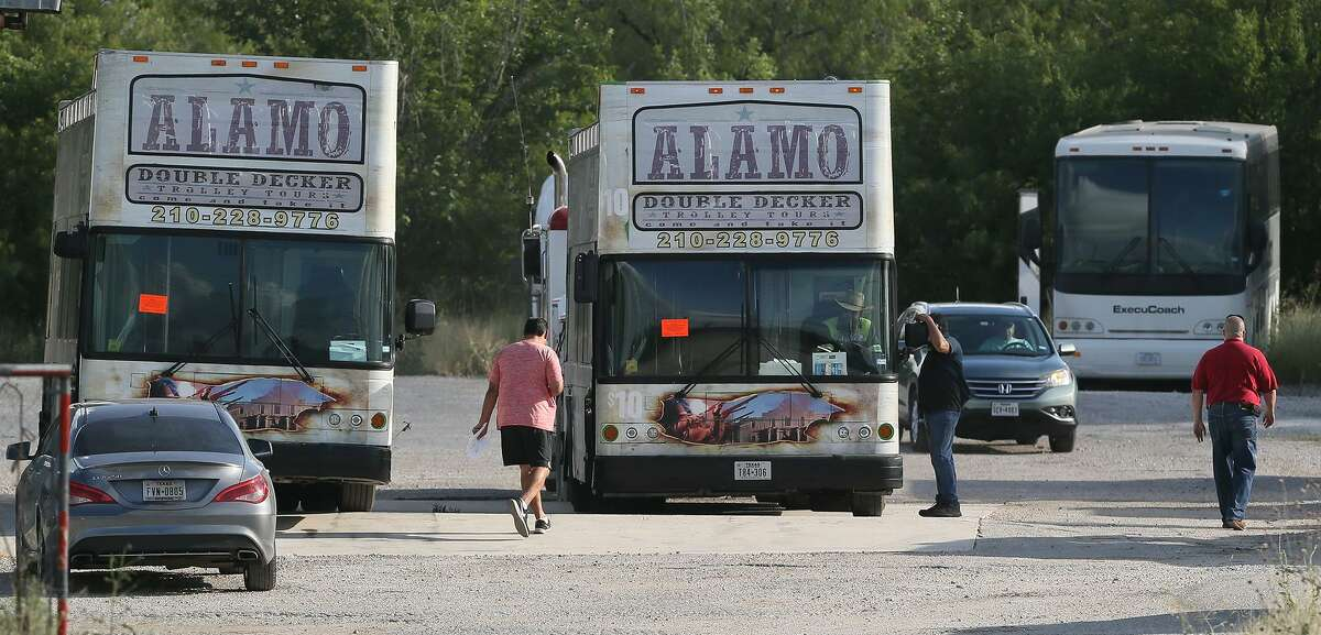 Two double-decker buses that Bexar County seized last month from San Antonio tour operator City Tours sold at auction for $57,000 and $56,000, respectively, Monday.
