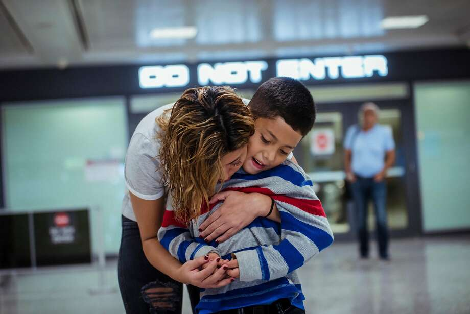 Brenda Garcia is reunited with her 7-year-old son, Kevin, at Washington Dulles International Airport in Dulles, Va., on June 29. The government faces deadlines to finish the reunifications. Photo: Ryan Christopher Jones / New York Times