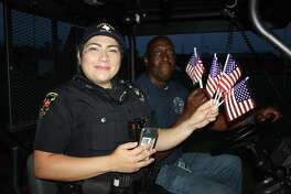 Cleveland Police Officer Erica Fleming and firefighter Roger Brooks got into the spirit of Independence Day on Saturday, albeit a few days after the holiday. The city of Cleveland's Fourth of July fireworks was scheduled for last Wednesday but heavy rains forced the event to be held Saturday. Hundreds of people packed the park to watch the show.