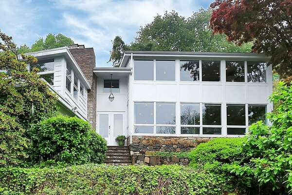 The contemporary house at 221 High Meadow Road sits on a 1.13-acre level and sloping property and is one of the most unusual houses in all of Fairfield; built into rock ledge and containing seven levels.