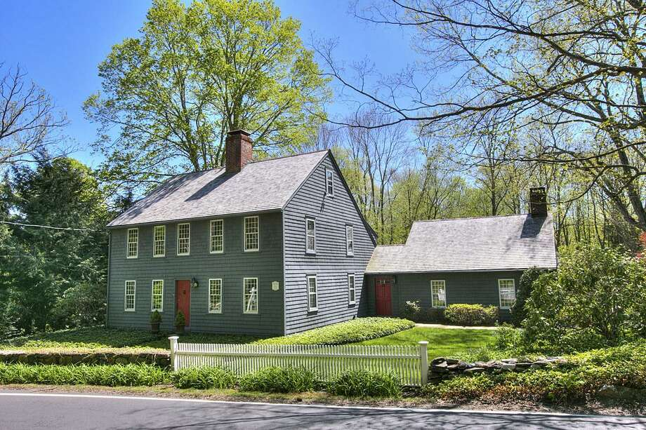 The blue-gray antique colonial saltbox at 14 Old Redding Road dates back to 1786 but has all the modern amenities todayÕs lifestyle requires.