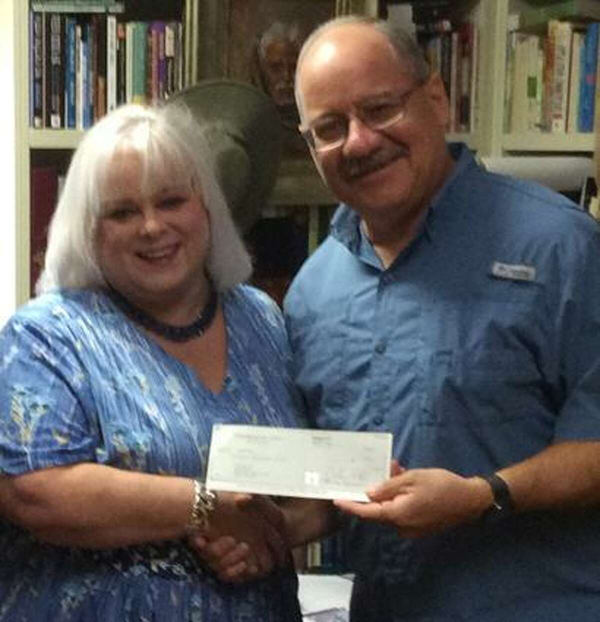 Kingsland Baptist Church is among the sponsors of Operation Back 2 School this year. Rhonda Player, Compassion Katy director of marketing, received a sponsorship check from Missions Pastor Omar Garcia.