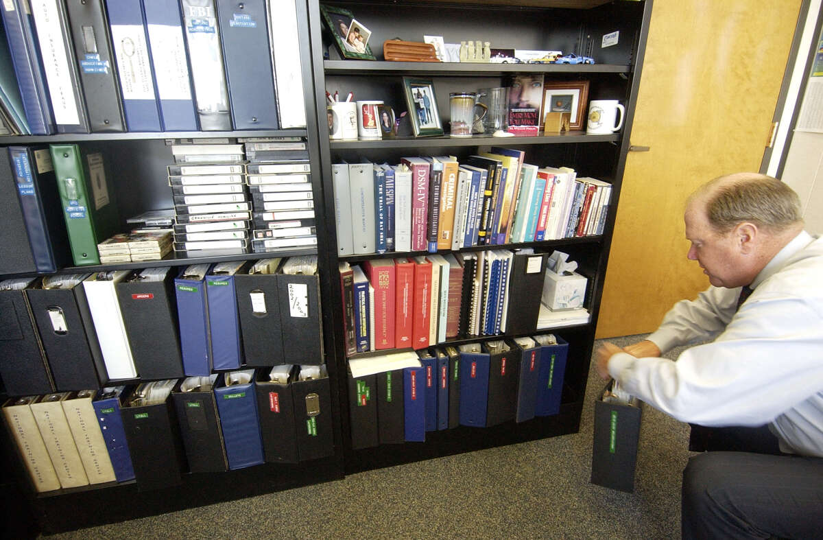 TIMES UNION STAFF PHOTO WILL WALDRON---Jim Horton, former State Police investigator who investigated the Gary Evans murders, keeps a large collection of his investigation files, at his office in Albany. Horton collaborated with author William Phelps on a new book on Gary Evans,