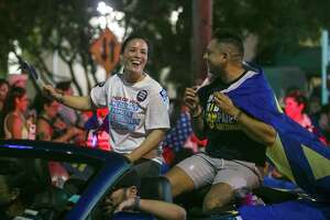 Congressional candidate Gina Ortiz Jones rides in the annual Pride San Antonio festival parade on June 30. She raised more than $1.2 million from April through June for her campaign in the race for Texas' 23rd Congressional District.