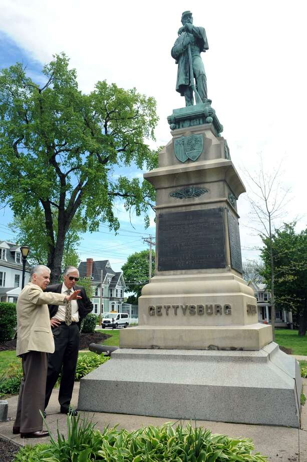 James Cohen, left, and Alan Tyma talk near the Civil War monument on the Derby Green, in Derby, Conn. May 18, 2016. They are coordinating efforts to raise funds to repair and refurbish monument. Photo: Ned Gerard / Hearst Connecticut Media / Connecticut Post