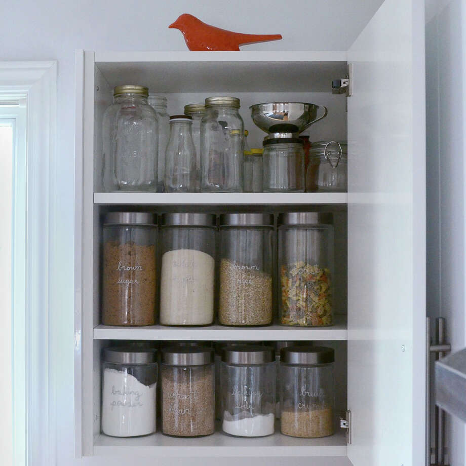 One of Tippi Thole's package-free cupboard. Since joining the Zero Waste movement, Tippi buys secondhand cups and glassware when possible. Photo: Photo By Tippi Thole. / The Washington Post