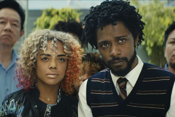 """This image released by Annapurna Pictures shows Tessa Thompson, left, and Lakeith Stanfield in a scene from the film, """"Sorry To Bother You."""""""