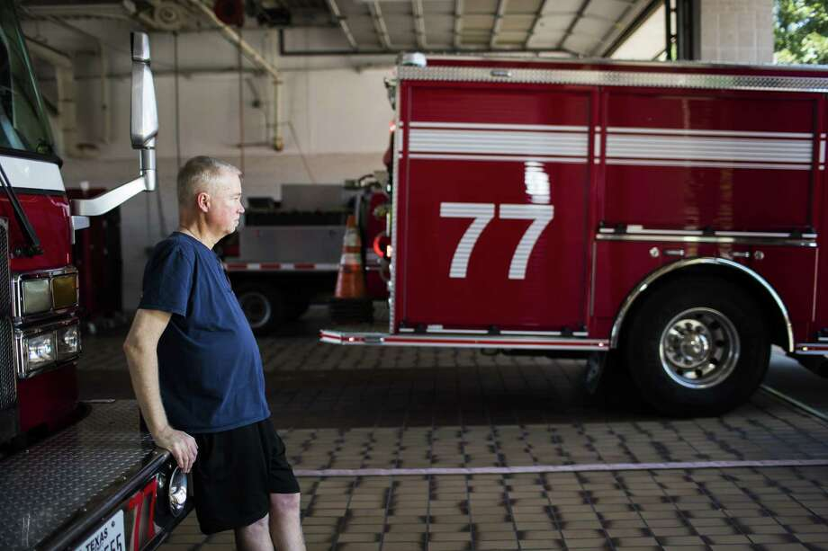 Scott Shaw, 49,  watches as the fire engine departs from the Houston Fire Station 77, Friday, July 6, 2018, in Houston. Shaw, says is hard to not being able to drive a fire engine like he used to now that he is medically discharged from the Houston Fire Department because he is battling cancer. ( Marie D. De Jesús / Houston Chronicle ) Photo: Marie D. De Jesús, Staff / Houston Chronicle / © 2018 Houston Chronicle