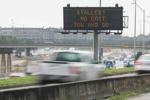A sign on Texas 288 near Southmore Boulevard announces the start of the Gulf Coast Regional Tow and Go Program on July 9. Houston-Galveston Area Council officials announced the start of the program, which allows for tows free of charge off Houston freeways for stranded motorists.