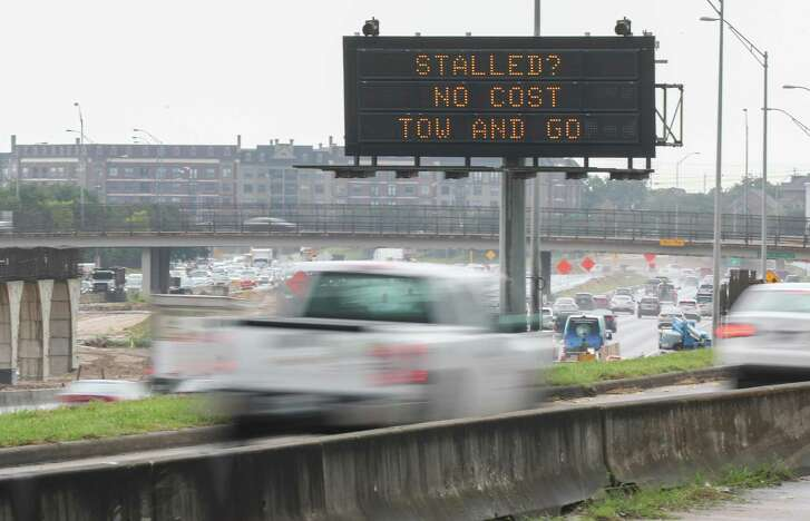 A sign on the South Freeway near Southmore Blvd announces the start of the Gulf Coast Regional Tow and Go Program Monday, July 9, 2018, in Houston. Stranded freeway motorists on Monday morning found themselves with a new option to get out of the way in Houston, courtesy of local transportation officials. Houston-Galveston Area Council officials announced the start of the Gulf Coast Regional Tow and Go Program, which allows for tows free of charge off Houston freeways for stranded motorists. With approval from police, a tow truck can be dispatched to move the vehicle to a safe location, up to one mile away. ( Steve Gonzales / Houston Chronicle )