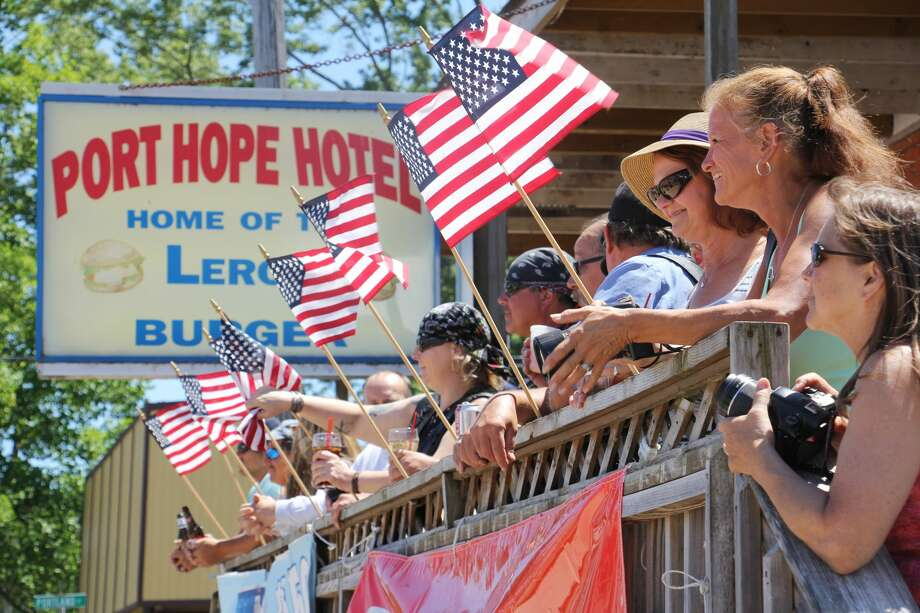 A group of patriotic spectators gathered outside of the Port Hope Hotel on Sunday to enjoy the town's annual Fourth of July parade. Photo: Bradley Massman/Huron Daily Tribune