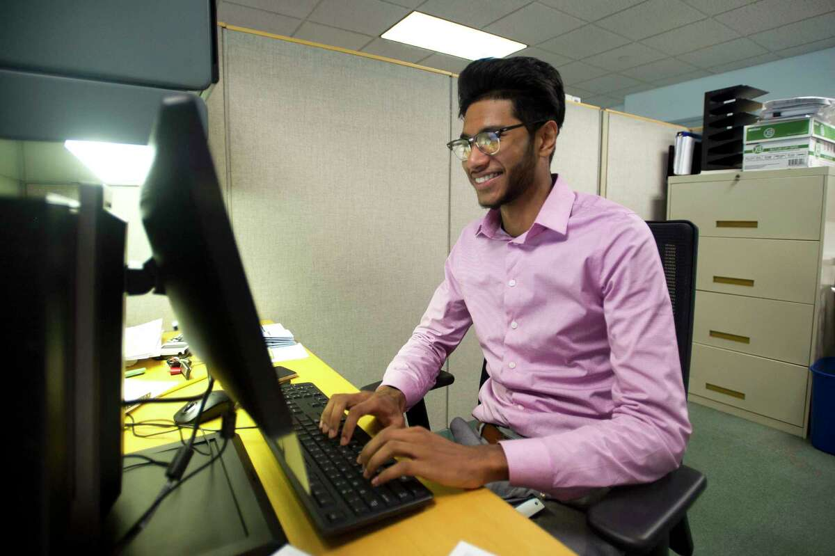 Ridwanoor Rashid, an intern in the city's Office of Policy and Management, poses for a photo at his desk inside Government Center in downtown Stamford, Conn. on Monday, July 9, 2018.