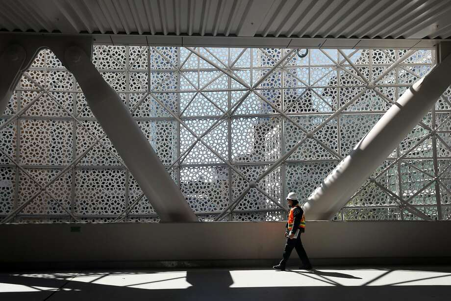 A view from inside looking out through the perforated shell on the third floor of the Salesforce Transit Center. Photo: Lea Suzuki / The Chronicle